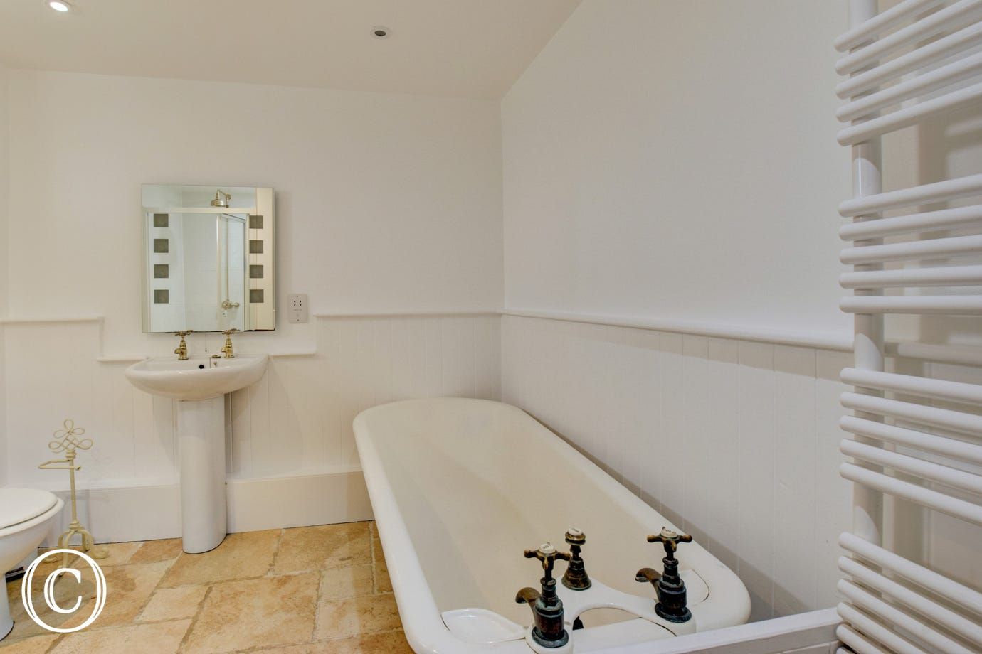 Family bedroom ensuite with shower & free standing roll top bath