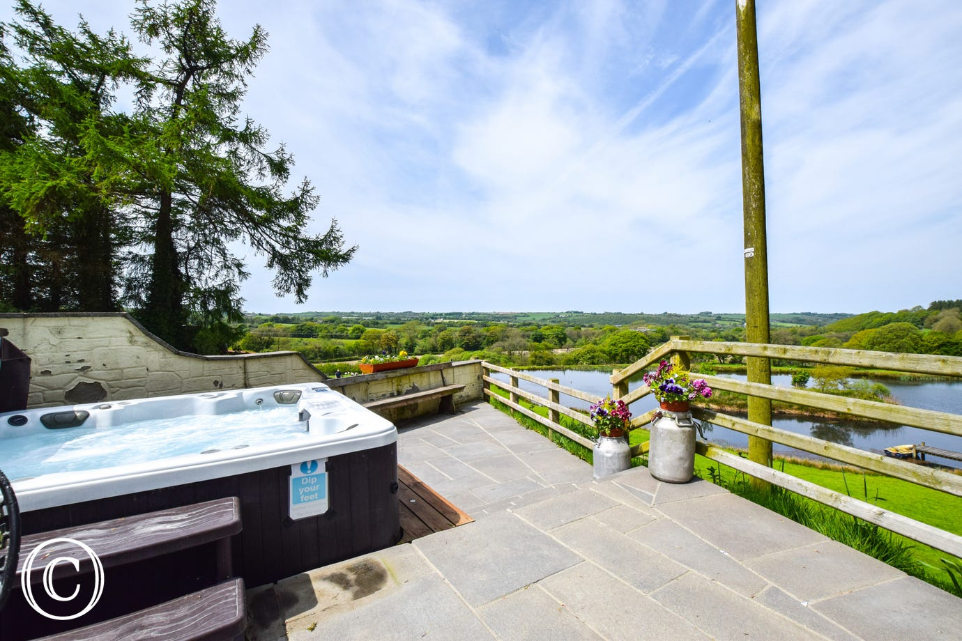 Hot-tub with views over the lake and surrounding countryside.