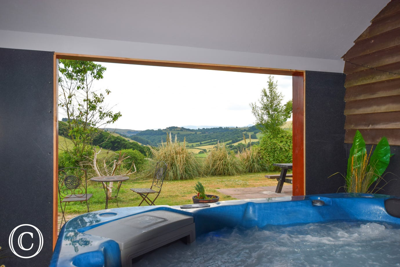 one of the two hot tubs on site