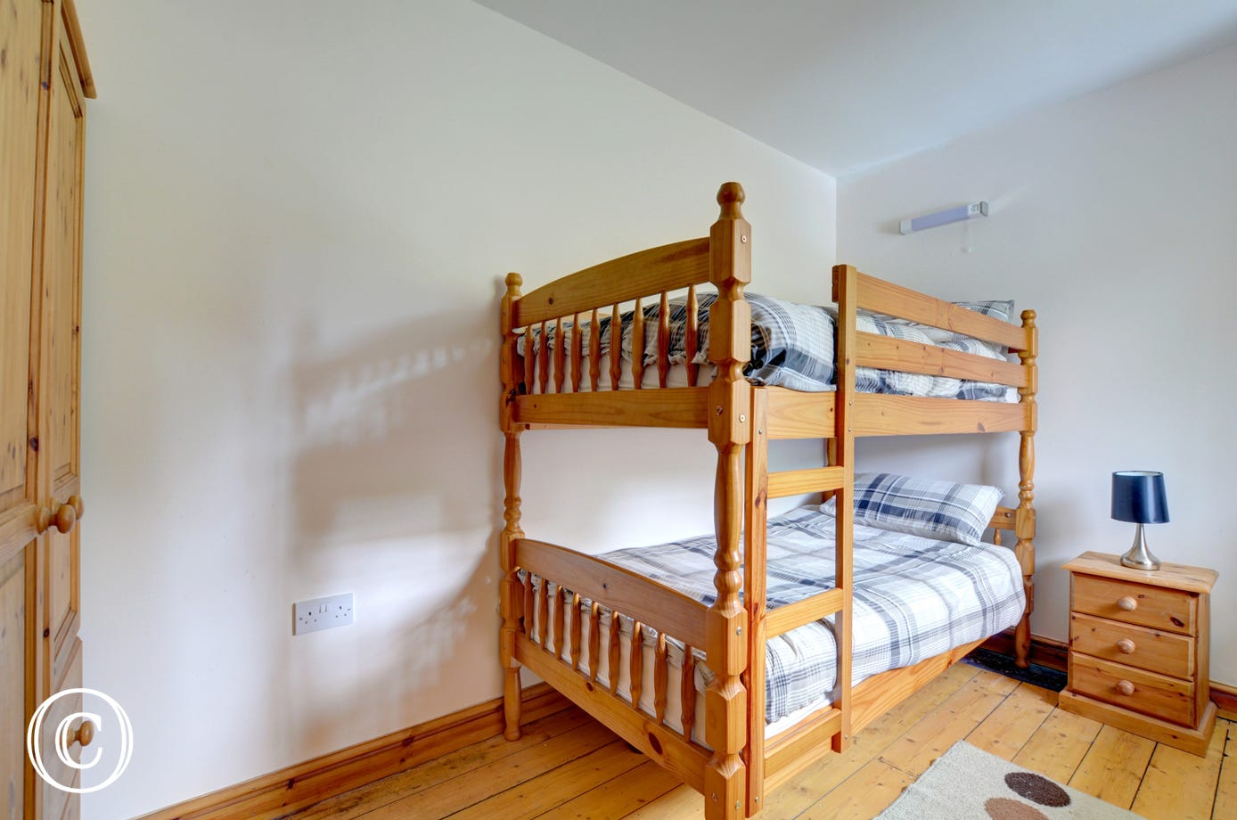 Bunk Bedroom with full sized bunks and pine furniture