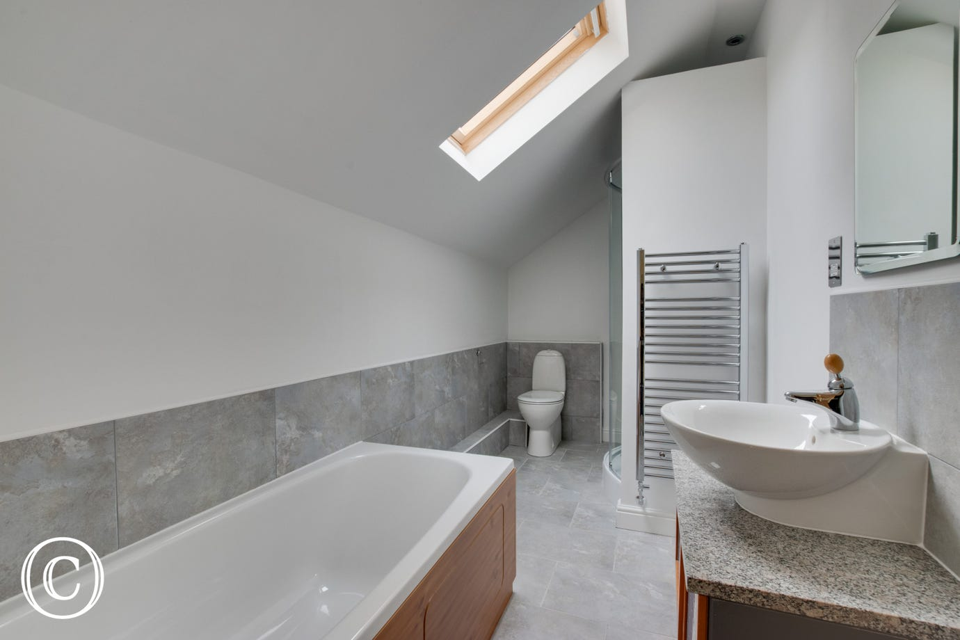 Bathroom includes bath and shower unit
