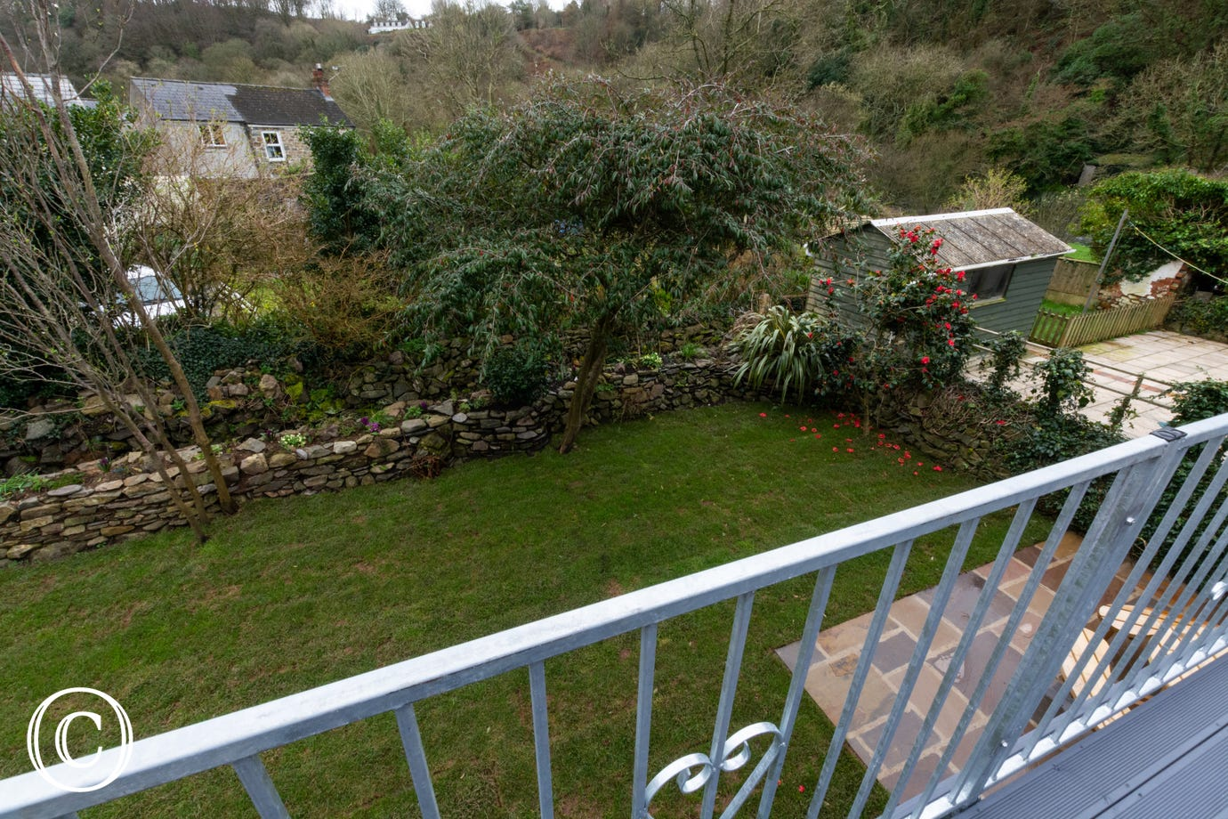 The rear garden and patio area from the first floor balcony