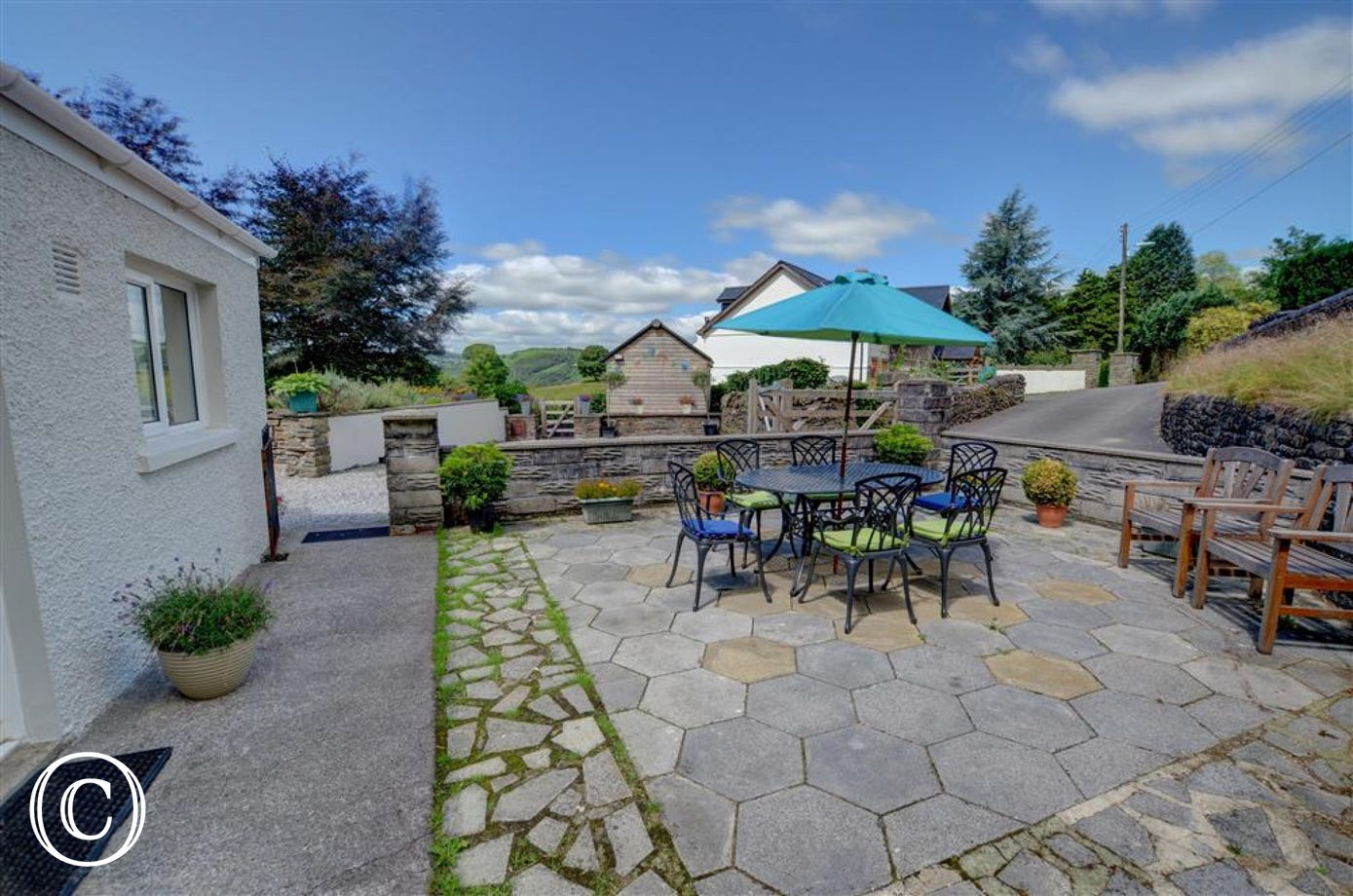 Patio with picnic furniture and countryside views