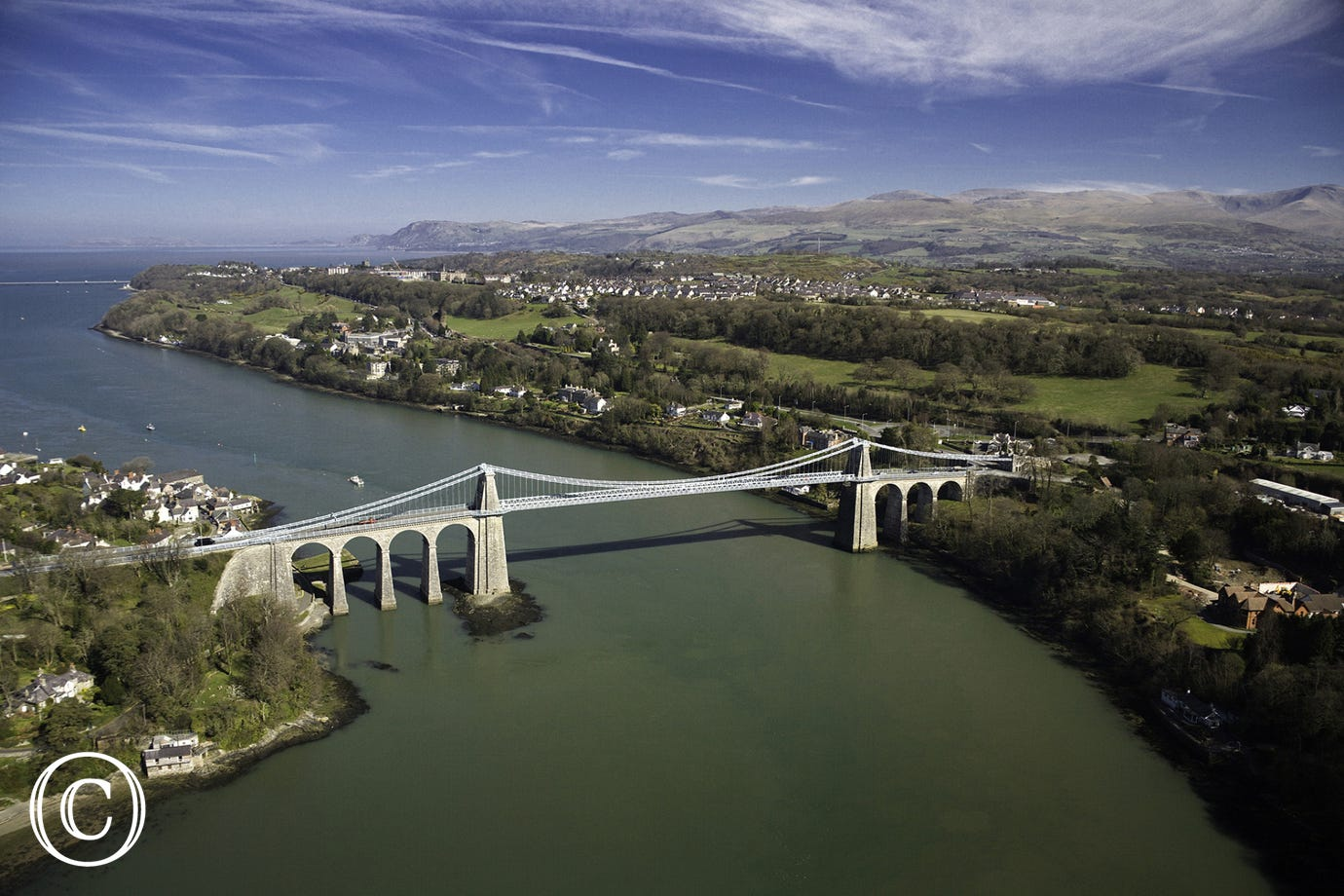 Britannia Bridge (in foreground) and Menai Bridge (background)
