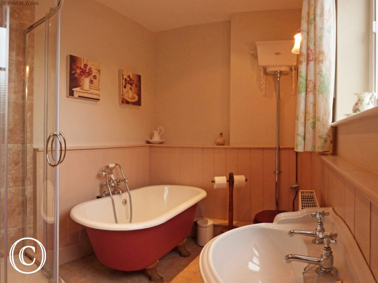 Bathroom with free standing, luxury bath and separate shower cubicle
