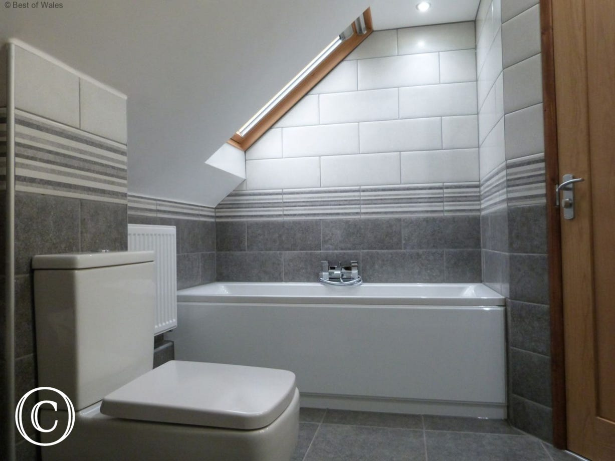 Family bathroom with a large walk-in shower, bath, WC and basin