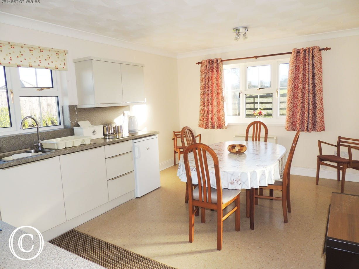 Spacious kitchen diner at this homely West Wales holiday cottage