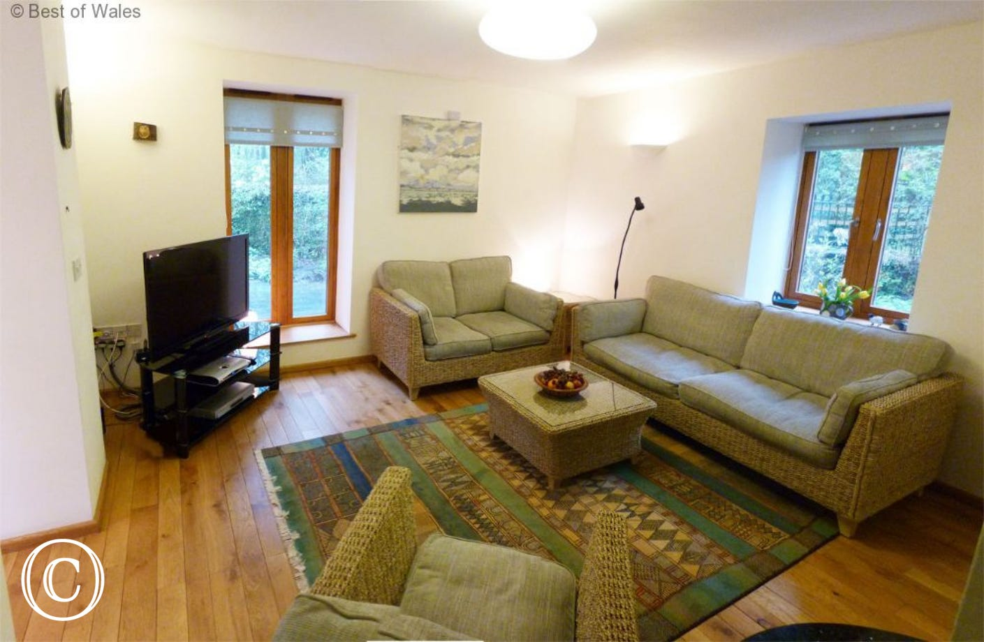 Lounge with stove at this cosy self catering, Brecon Beacon