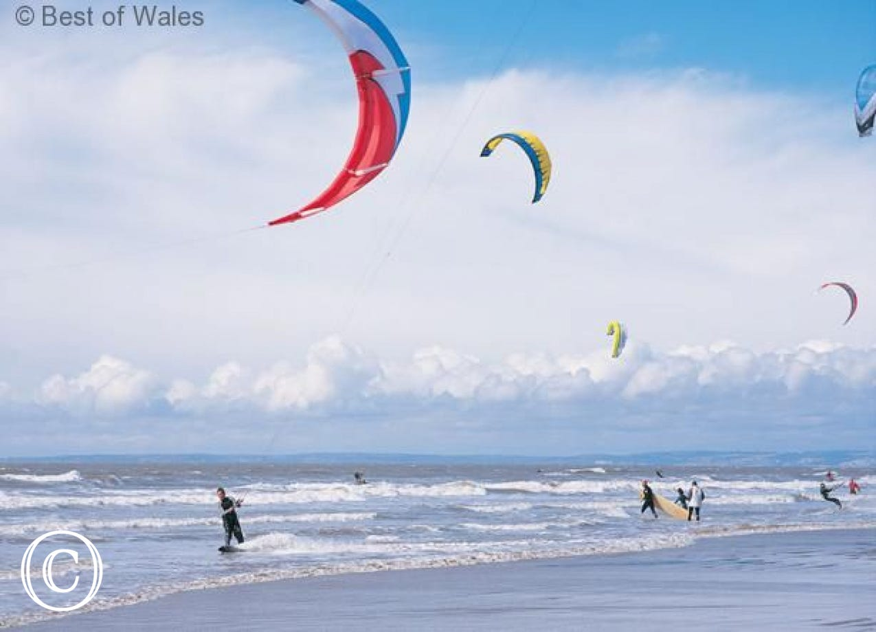 Kite surfing at Rest Bay, Porthcawl; less than 3 miles from your cottage