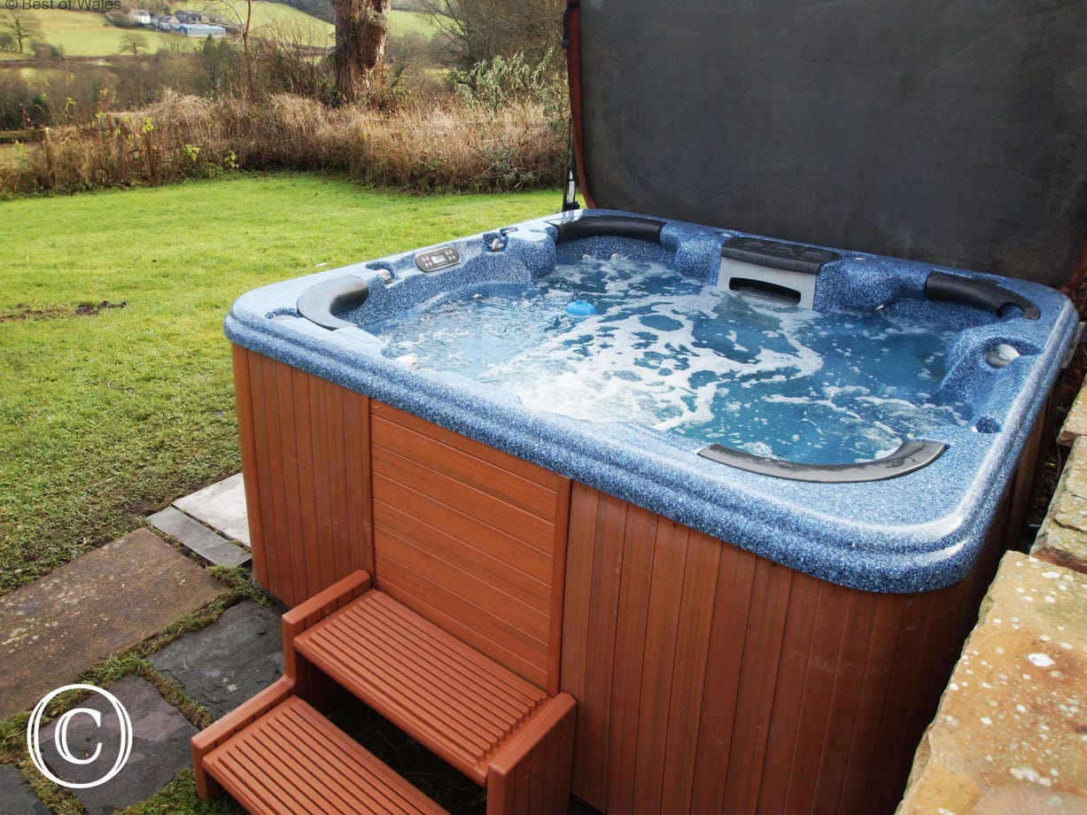 Relax in the hot tub and look out over stunning countryside