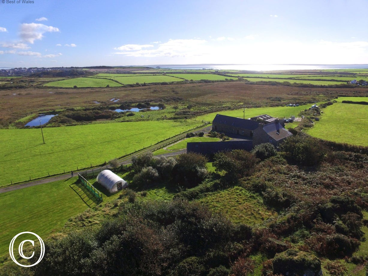 Aerial view looking East over the cottage