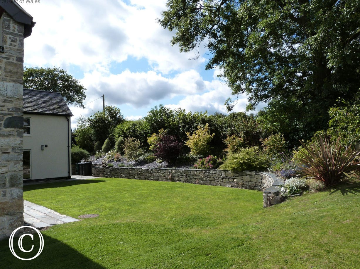 Large rear garden at this detached holiday cottage in North Wales