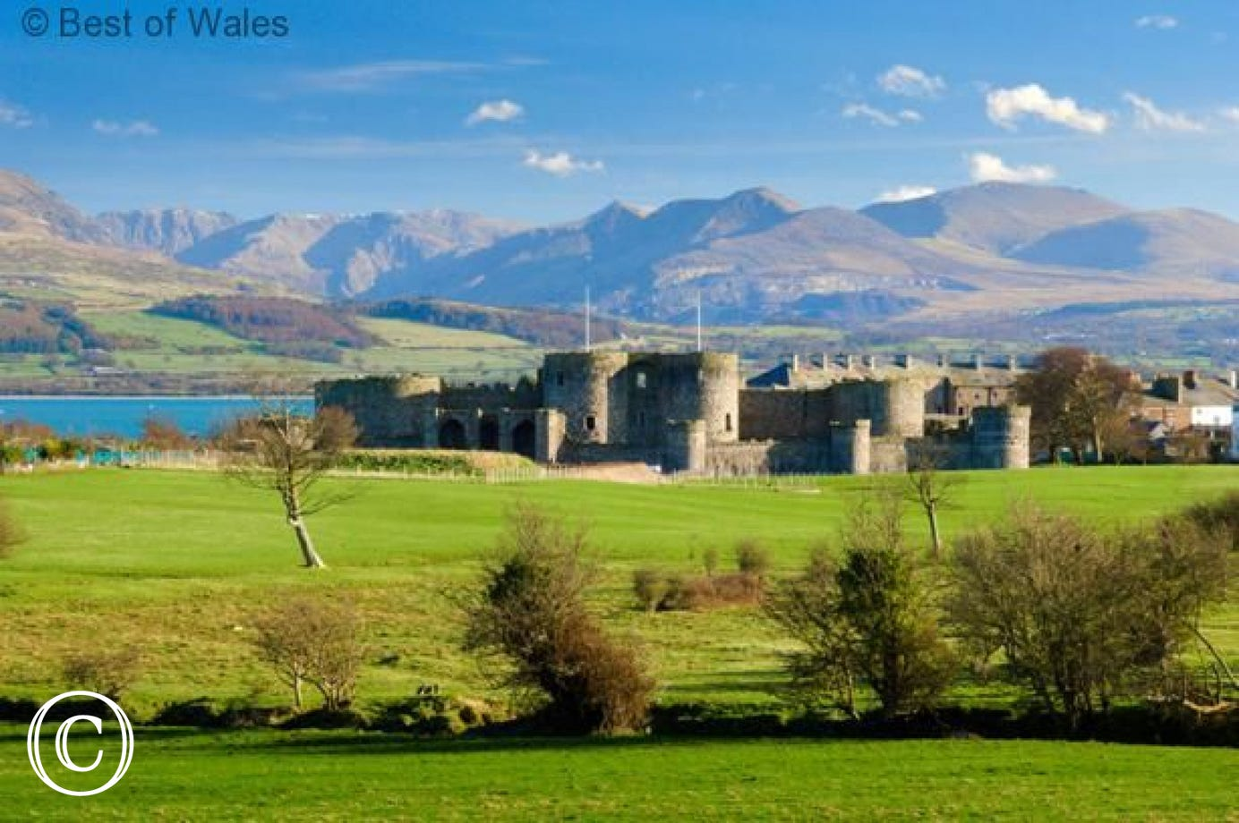 Beaumaris Castle with Menai Strait and Snowdonia in the background