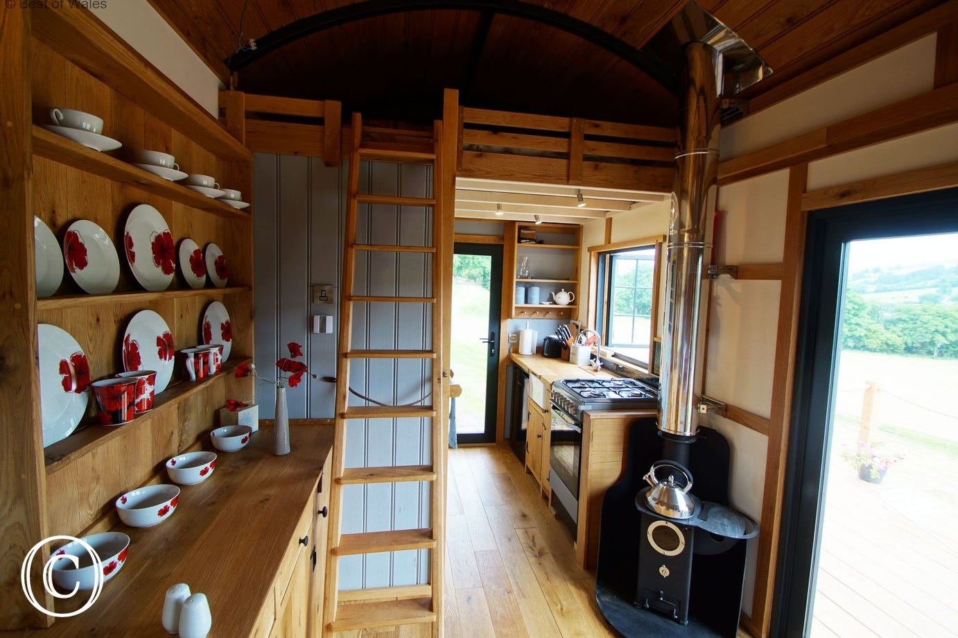 Wood burning stove and fully equipped kitchen unit.