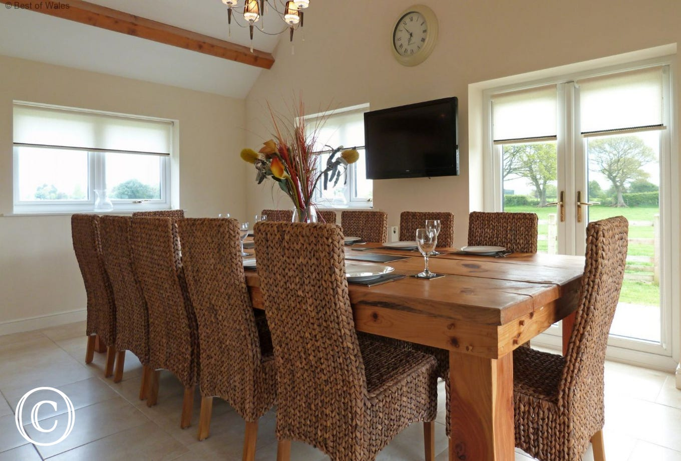 Large dining table with wall mounted TV and stunning views