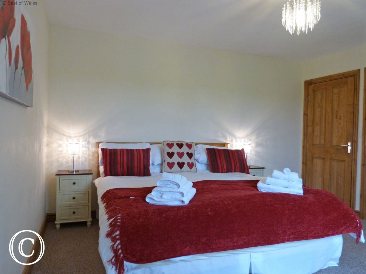 Bedroom 5: Super king size bed. Luxury self catering in North Wales