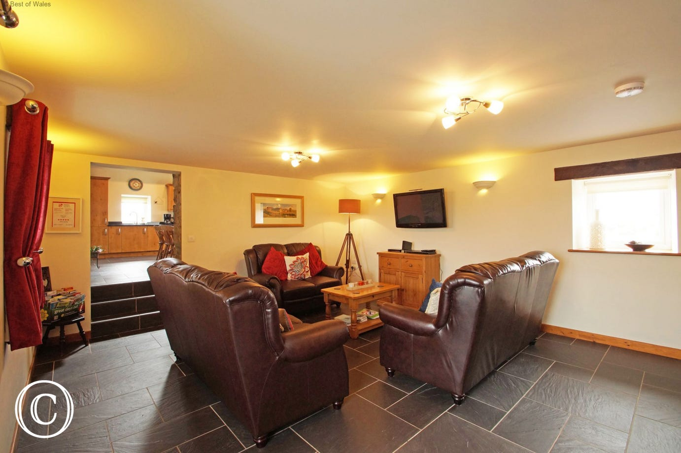 Spacious living room with leather settees and underfloor heating
