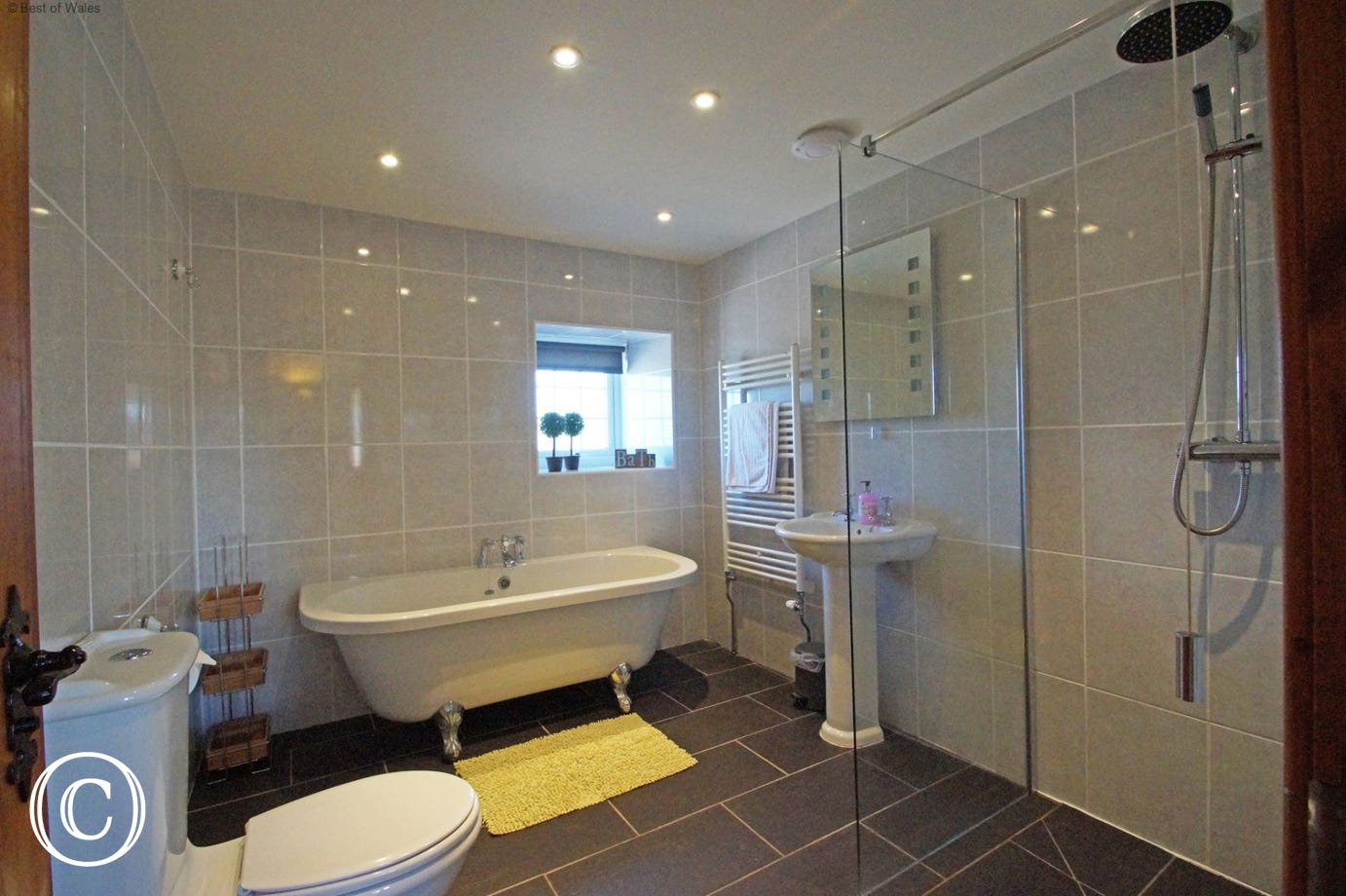 Ground floor bathroom with freestanding bath & wet-room style shower