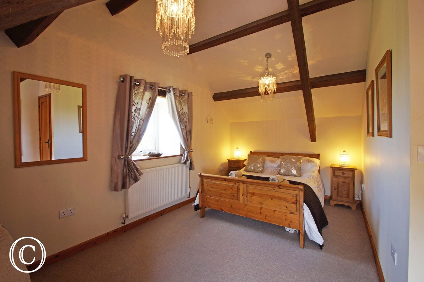 Upstairs double room with a beautiful pine sleigh bed & stunning views