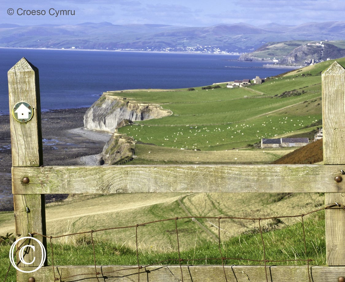 Wales Coast Path: View over stile near Llanrhystud north towards Aberystwyth