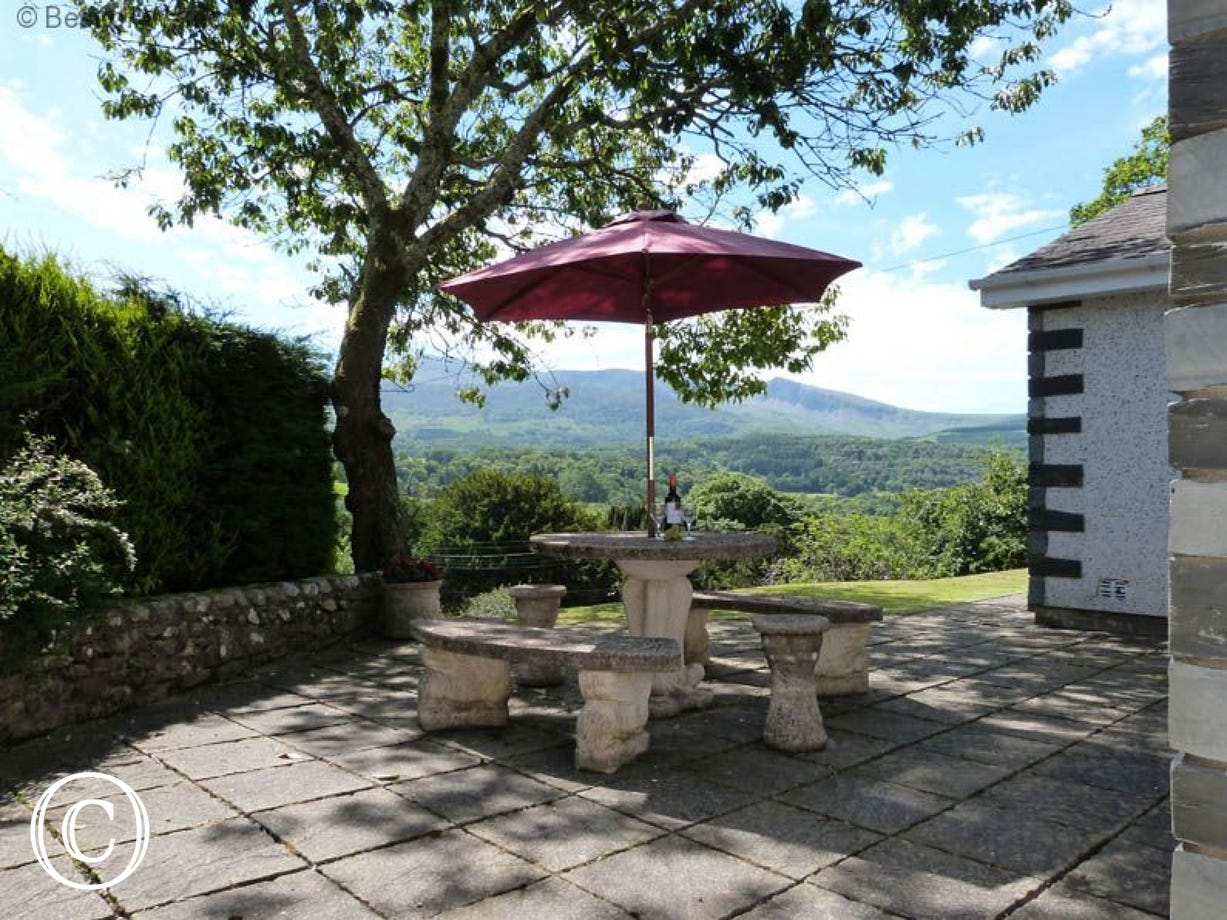 Enclosed patio & lawn at the front of this self catering Dolgellau cottage
