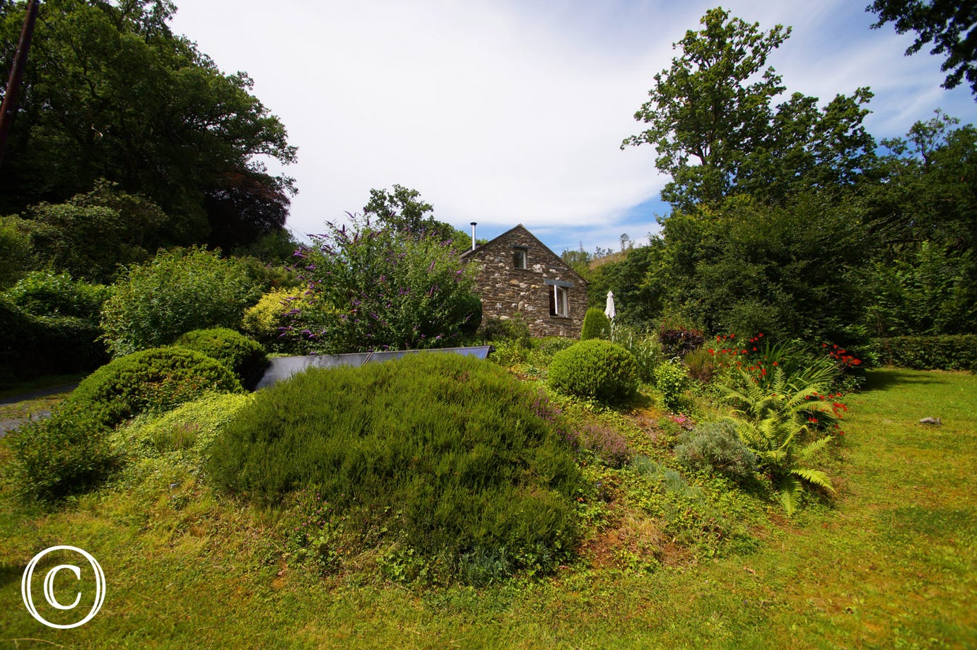 This eco-friendly cottage is surrounded by luxuriant gardens