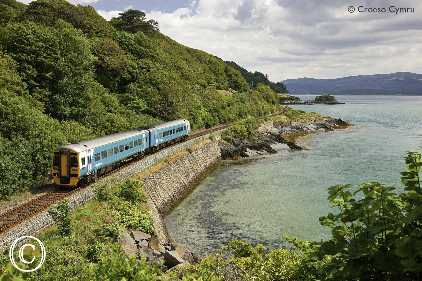 Catch the train from Machynlleth to Aberdyfi and along the coast to Pwllheli