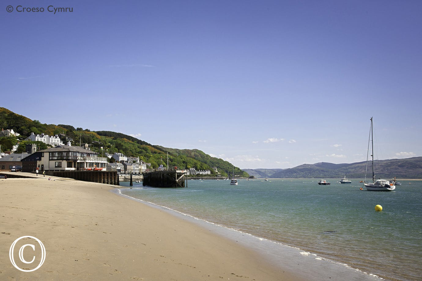 Aberdyfi's long sandy beach on the northern side of the Dyfi Estuary