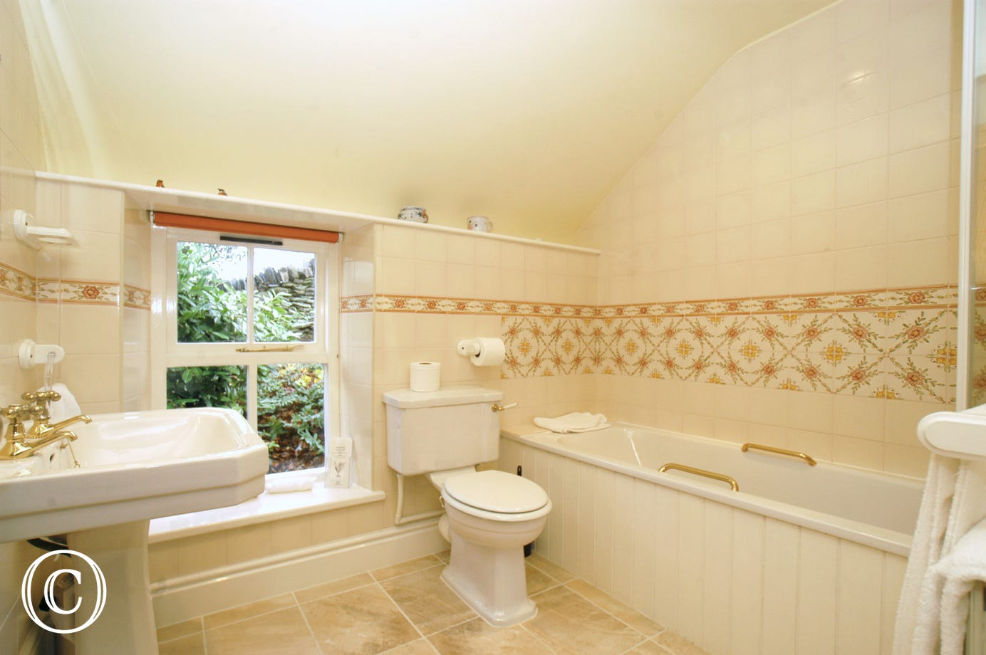 En-suite in family bedroom includes bath & shower