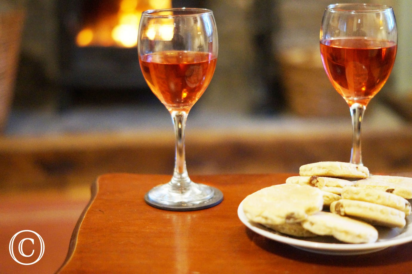 welsh cakes and wine in front of the fire