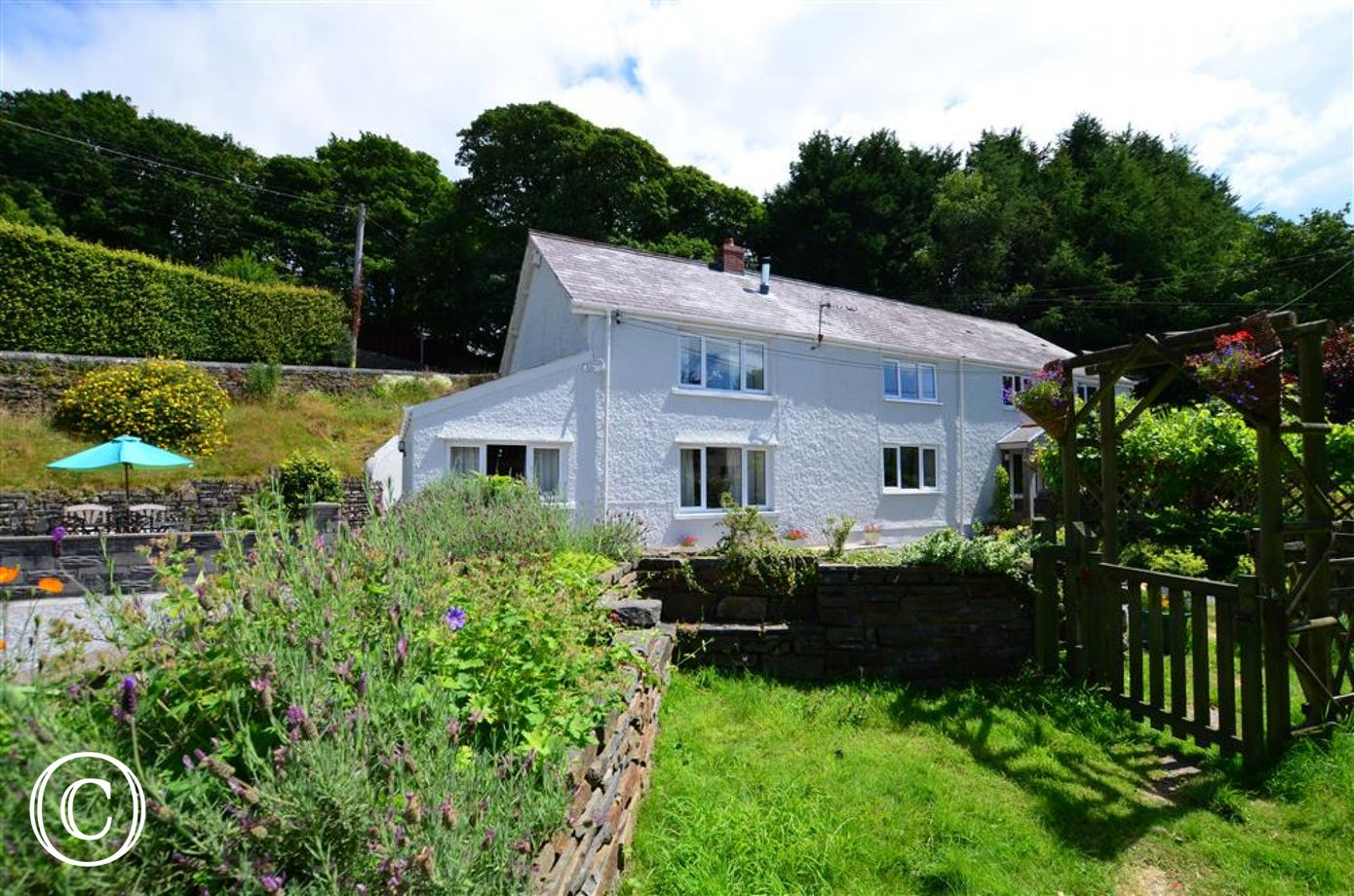2 Tan-yr-Eglwys adjoins the larger cottage, WAY166,  in the hamlet of Cilybebyll near Swansea