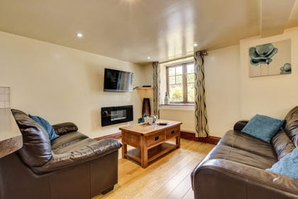 Cosy lounge includes fireplace, widescreen TV/DVD & leather sofas