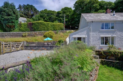 2 Tan-yr-Eglwys is a semi-detached stone cottage with patio and garden