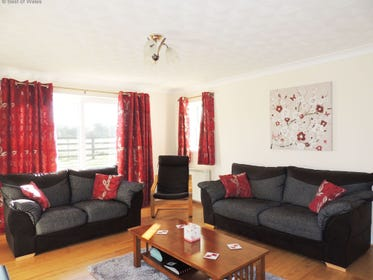 Large comfy lounge at this West Wales holiday cottage