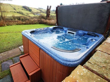 The private hot tub at Onnen Fawr Farmhouse