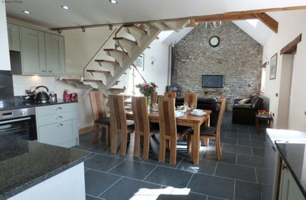 Modern open plan kitchen, dining & living room with underfloor heating